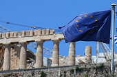 An EU flag flys in front of the ancient Parthenon temple on top of the Acropolis hil on July 12 2015 in Athens Greece The people of Greece continue...