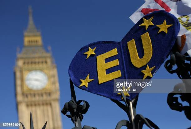 TOPSHOT An EU themed placaard is pictured on a railing near the houses of Parliament during a rally follwing an anti Brexit proEuropean Union march...