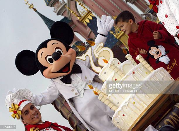 WITH 'MICKEY TURNS 75' An Euro Disney employee wearing a Mickey Mouse celebrates 18 November 2003 the famous mouse's 75 birthday at Disneyland in...