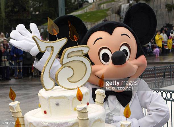 WITH 'MICKEY TURNS 75' An EuroDisney employee wearing a Mickey Mouse celebrates the famous mouse's 75 birthday at the Eurodisney resort in...