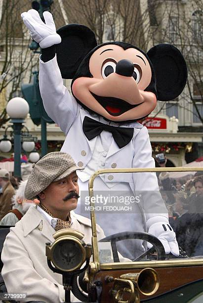 WITH 'MICKEY TURNS 75' An EuroDisney employee wearing a Mickey Mouse parades when celebrating the famous mouse's 75 birthday at the Eurodisney resort...