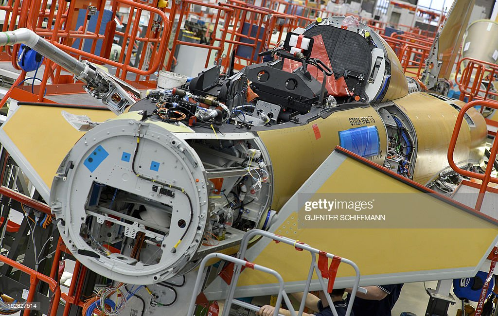An Eurofighter plane under construction destined for the German Air Force is seen at the production line of the EADS company Cassidian in Manching, southern Germany, on February 28, 2013.