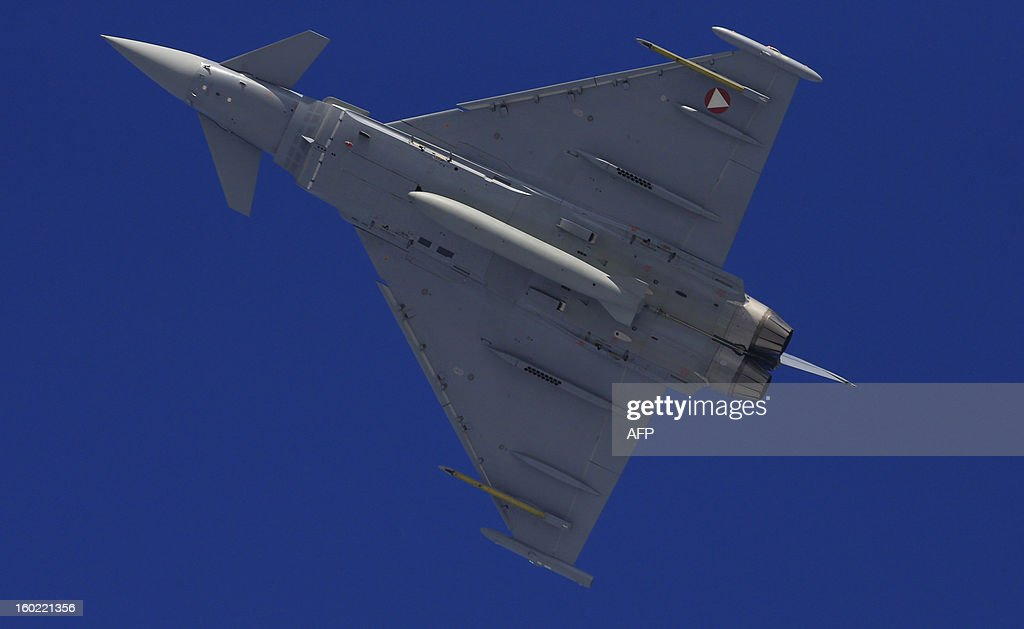 An Eurofighter Typhoon, twin-engine jet fighter from the Austrian Air Force (Bundesheer) is seen in the sky over Kitzbuehel during an air performance on January 26, 2013.
