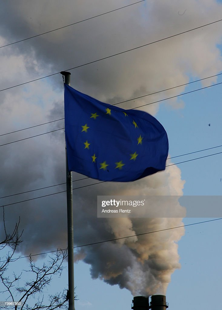 An European (EU) flag seen near the smoking power plant in Berlin Spandau on March 19, 2007 in Berlin, Germany. Dirty air, dirty water, mosquitoes - 13 million persons in the year must die according to the world health organization (WHO) as they live in a pollutet environment.