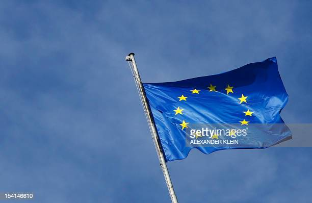 An European Union flag is seen in Vienna on October 15 2012 AFP PHOTO / ALEXANDER KLEIN