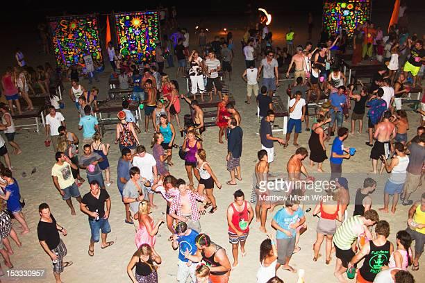 An evening dance party on the beach.