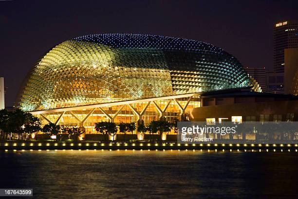 An evening view of the Esplanade and the attached Theatres on the Bay the durianshaped arts center on the Singapore waterfront