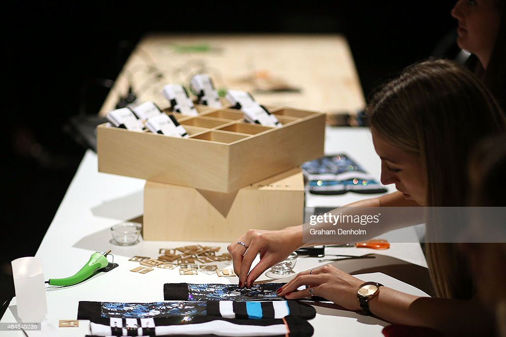 An event attendee glues Swarovski crystals to a sock during the Knock your socks off accessories style session at Mercedes-Benz Fashion Week Australia - Weekend Edition at Carriageworks on April 13, 2014 in Sydney, Australia.