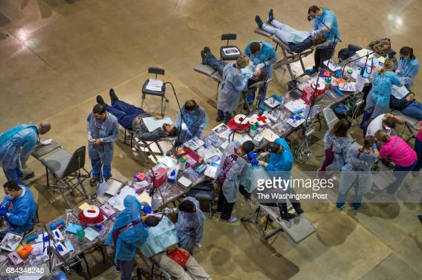 An event center floor doubles as a makeshift dental surgery area during the Eastern Shore Mission of Mercy dental clinic in in Salisbury MD on March...