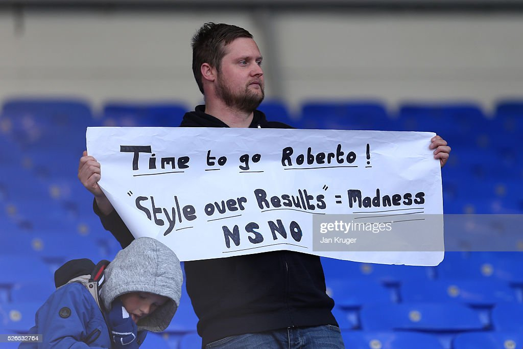 An Everton supporter holds banner 'Time to go Roberto!'' after the Barclays Premier League match between Everton and A.F.C. Bournemouth at Goodison Park on April 30, 2016 in Liverpool, England.