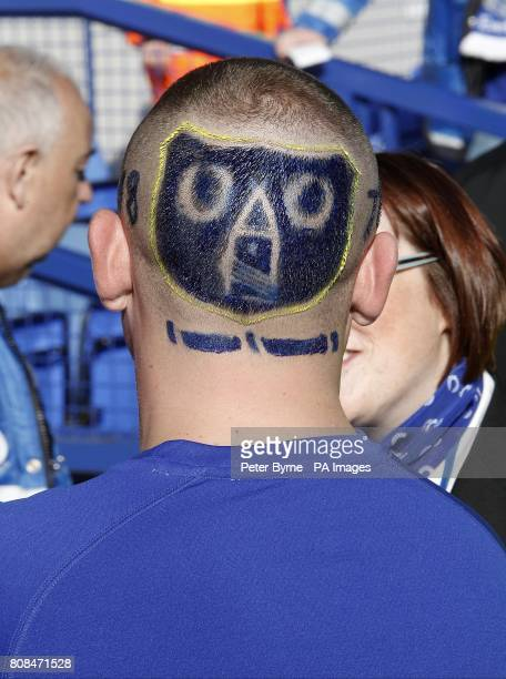 An Everton suppporter who has the club's emblem shaved onto the back of his head in the stands