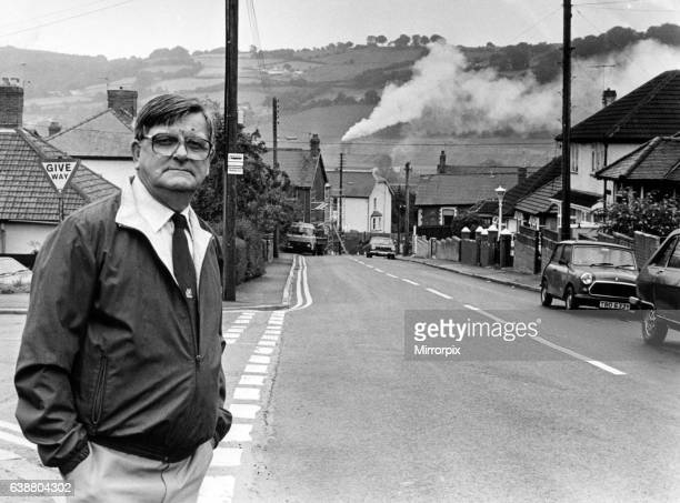 An everyday scene in Risca Mr John Herbert pictured in Gelli Avenue with the smoke billowing from the Brickhouse Dudley factory chimney Valley...