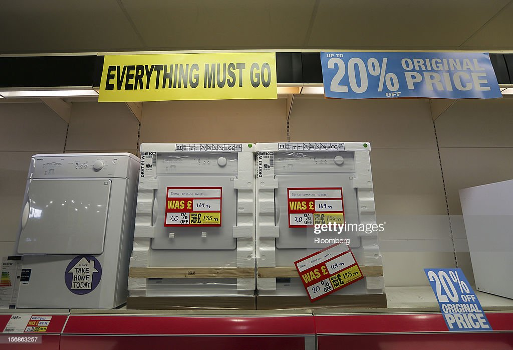 An 'Everything Must Go' sign hangs above a display of reduced-price Beko tumble dryers, manufactured by Arcelik AS, inside a Comet electronics store in Slough, U.K., on Friday, Nov. 23, 2012. Comet, a U.K. electronics chain, appointed Deloitte LLP as insolvency administrator, less than a year after being bought by private-equity firm OpCapita LLP. Photographer: Chris Ratcliffe/Bloomberg via Getty Images