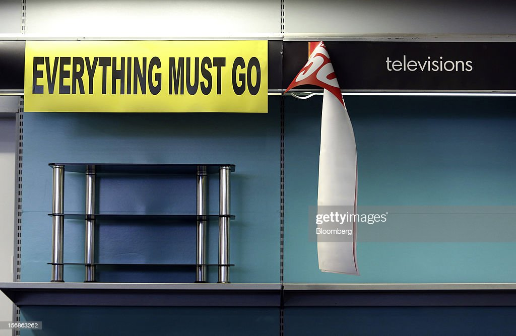 An 'Everything Must Go' sign hangs above a single television stand inside a Comet electronics store in Slough, U.K., on Friday, Nov. 23, 2012. Comet, a U.K. electronics chain, appointed Deloitte LLP as insolvency administrator, less than a year after being bought by private-equity firm OpCapita LLP. Photographer: Chris Ratcliffe/Bloomberg via Getty Images