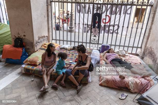 An evicted woman sleeps on mattress under the colonnade waiting for the meeting with the Prefecture on August 16 2017 in Rome Italy 100 families were...