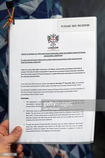 An eviction notice hangs on a tent sit outside St Paul's Cathedral on November 16 2011 in London England A legal notice from The City of London...