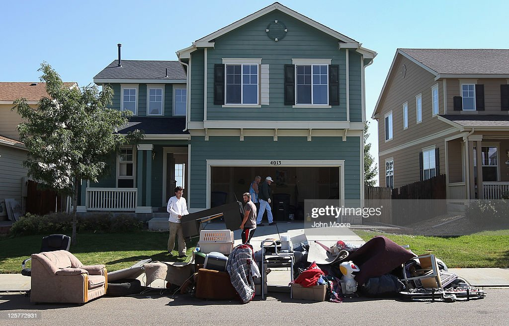 An eviction team removes furniture during a home foreclosure on September 21, 2011 in Longmont, Colorado. The family had already moved out of the four-bedroom house, leaving some furniture to be removed to the street after the sheriff's department served the court order for the eviction. Although sales of previously owned homes have risen nationally, the glut of foreclosures is expected to keep the rise in home values below the rate of inflation for years.