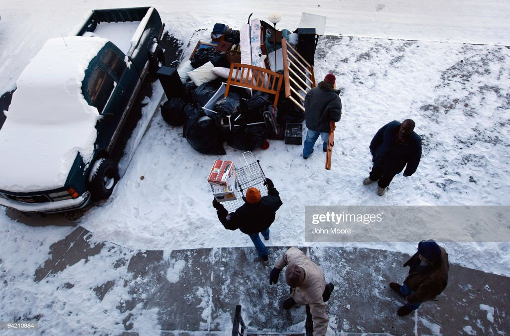 An eviction team removes furniture from an apartment on December 9, 2009 in Colorado Springs, Colorado. The tenants had fallen two behind months in their rent payments. Evictions and foreclosures nationwide continue at high levels, as unemployed Americans find themselves unable to make monthly payments.