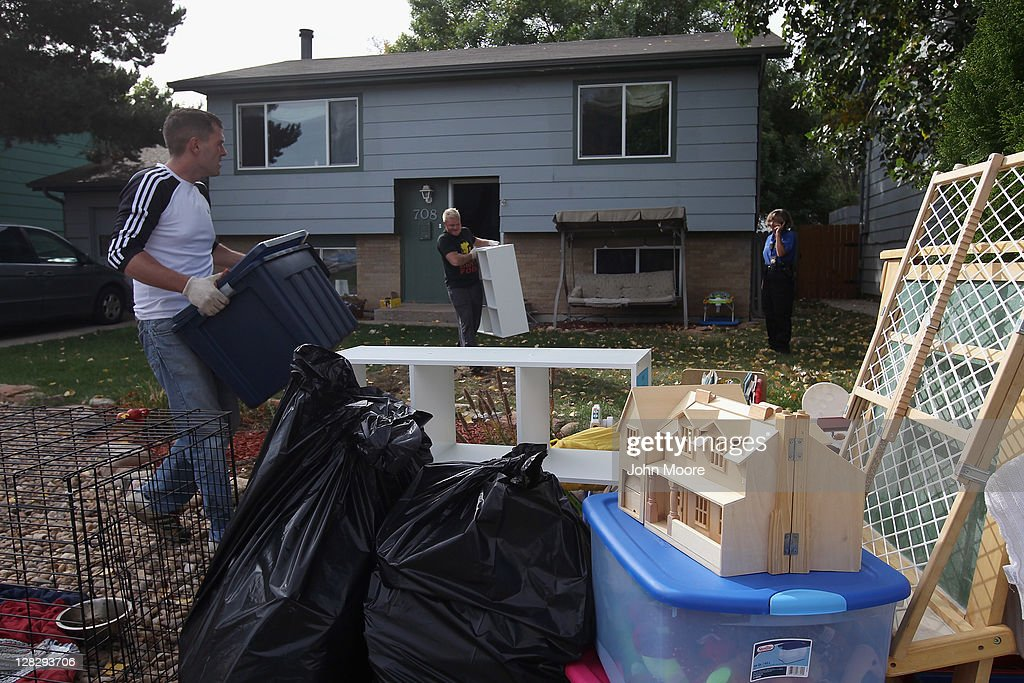 An eviction team removes household belongings from the children's room during a home foreclosure on October 5, 2011 in Milliken, Colorado. The owners had stopped making mortgage payments some 11 months before, and the bank took possession of their home after receiving a court order. A nationwide glut of foreclosed homes is expected to depress U.S. housing values for years.