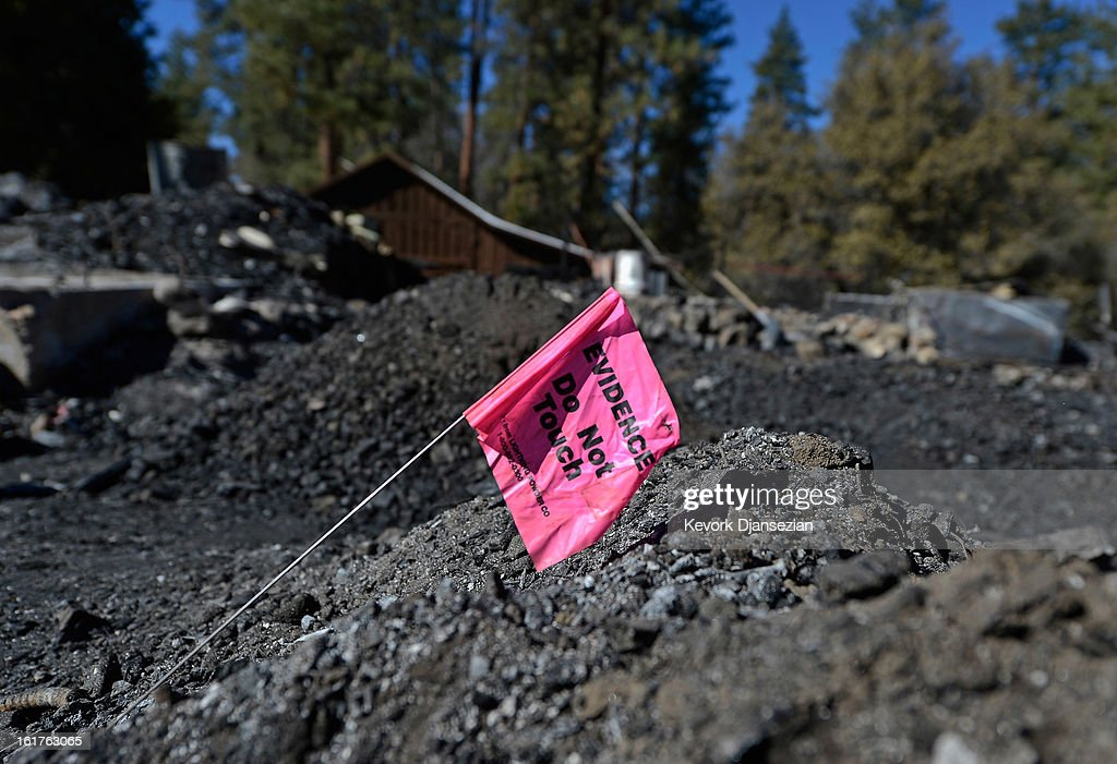 An evidence flag belonging to San Bernardino County Sheriff's crime scene investigators sits on pile of rubble inside the burned out cabin where the remains of multiple murder suspect and former Los Angeles Police Department officer Christopher Dorner were found is seen on February 15, 2013 in Big Bear, California. Dorner, a former Los Angeles Police Department officer and Navy Reserve veteran, barricaded himself in the cabin near Big Bear, California, and engaged law enforcement officers in shootout, shooting two police, killing one and wounding the other. Dorner's, who's body was identified after being found, was wanted in connection with the deaths of an Irvine couple and a Riverside police officer.