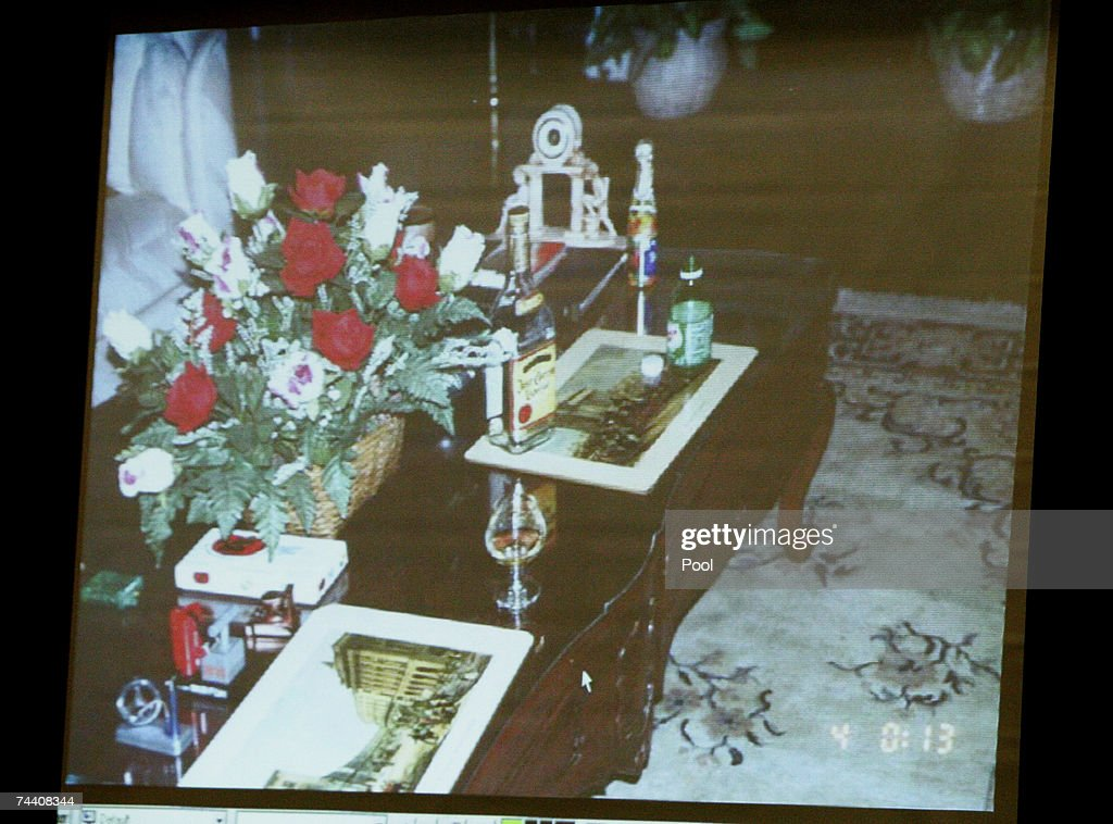 An evidence photograph taken in the living room of Phil Spector?s house is displayed on a screen during the morning session of Spector's murder trial at Los Angeles Superior Court June 5, 2007 in Los Angeles. Spector, 67, is accused of the murder of actress Lana Clarkson, who was found shot dead in Spector's Alhambra, California mansion on February 3, 2003.