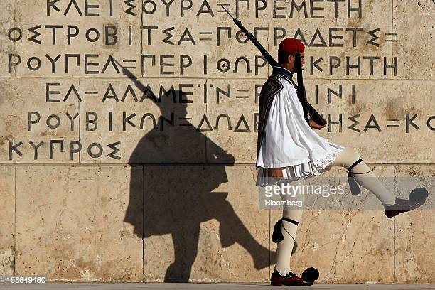 An Evzone presidential guard marches past the tomb of the unknown soldier near of the Greek parliament building in Athens Greece on Sunday Oct 7 2012...