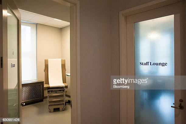 An examination room is seen next to a door marked 'Staff Lounge' at the Oscar Center in the Brooklyn borough of New York US on Wednesday Dec 7 2016...