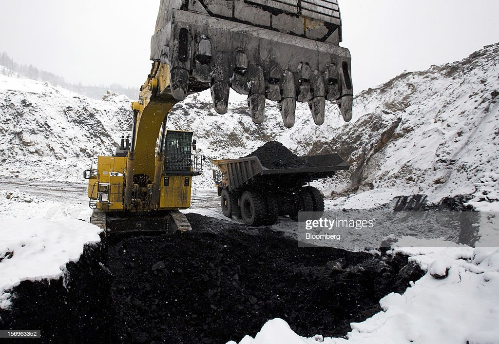 An excavator loads a truck with freshly dug coal at the Sibirginsky open pit coal mine, owned by OAO Mechel and operated by Southern Kuzbass Coal Co., near Myski, in Kemerovo region of Siberia, Russia, on Friday, Nov. 23, 2012. OAO Mechel is Russia's biggest maker of steelmaking coal. Photographer: Andrey Rudakov/Bloomberg via Getty Images