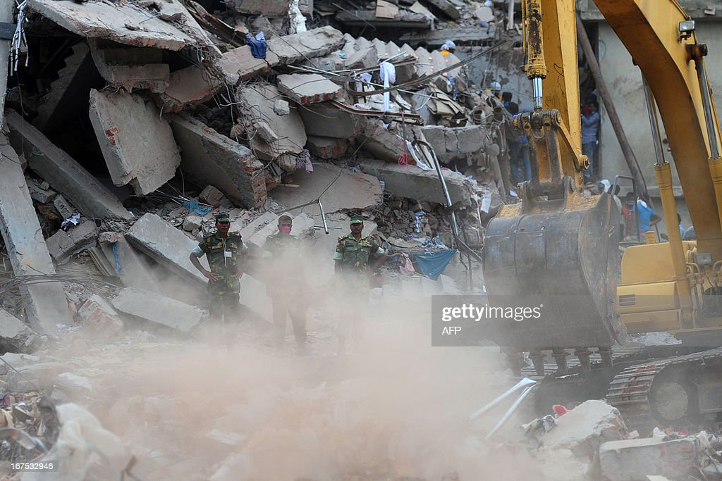An excavator operated by the Bangladeshi Army removes debris as volunteers and rescue workers conduct rescue operations 60 hours after an eight-storey building collapsed in Savar, on the outskirts of Dhaka, on April 26, 2013. A total of 304 people are so far known to have died after the eight-storey building collapsed in the town of Savar on April 24. Rescuers are racing against time to find more survivors in searing temperatures, watched on by hundreds of anxious relatives waiting for news of their missing loved ones.