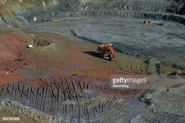 An excavator operates in the Neptune open pit mine at the St Ives Gold Mine operated by Gold Fields Ltd in Kambalda Australia on Wednesday Aug 9 2017...