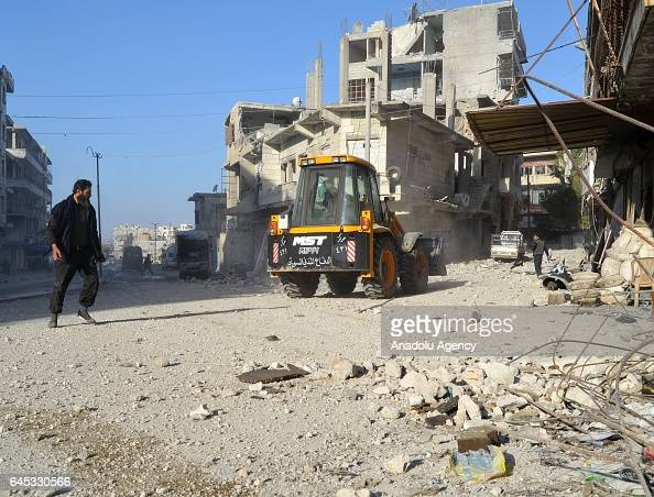 An excavator removes debris at the impact site after Assad Regime's airstrike over civilians in residential areas of Ariha town of Idlib Syria on...