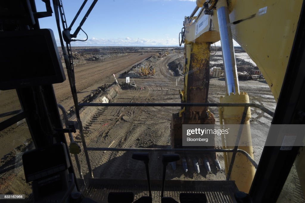 An excavator sits in a workshop area of the St Ives Gold Mine operated by Gold Fields Ltd. in Kambalda, Australia, on Wednesday, Aug. 9, 2017. Global gold deals have also slowed, declining to $19.8 billion in 2016 from $22.8 billion a year earlier, according to data complied by Bloomberg.Photographer: Carla Gottgens/Bloomberg via Getty Images