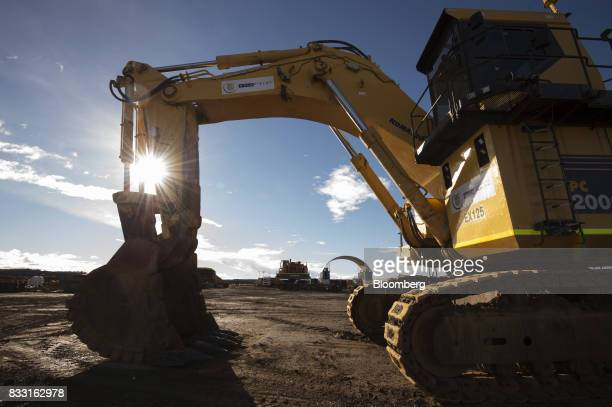 An excavator sits in a workshop area of the St Ives Gold Mine operated by Gold Fields Ltd in Kambalda Australia on Wednesday Aug 9 2017 Global gold...