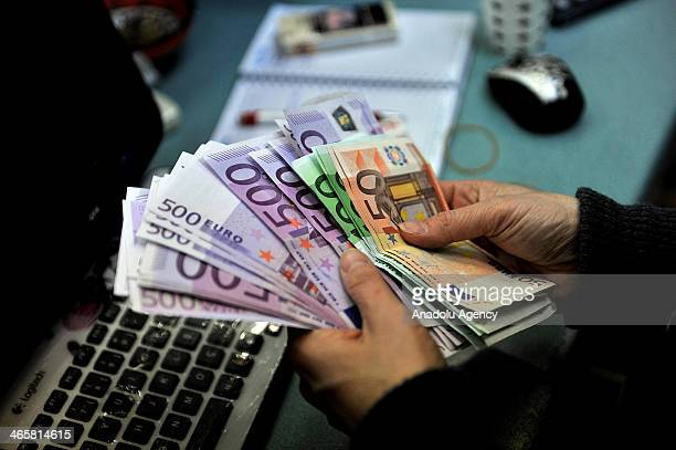 An exchange office clerk counts Euro banknotes in Istanbul Turkey January 29 2014 Turkey Central Bank raised the overnight interest rates with the...
