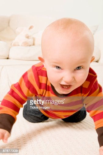 An excited baby crawling to camera. : Stock Photo