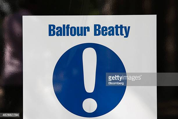 An exclamation mark sits on a temporary Balfour Beatty Plc sign on display at a construction site in the Euston district of London UK on Friday July...