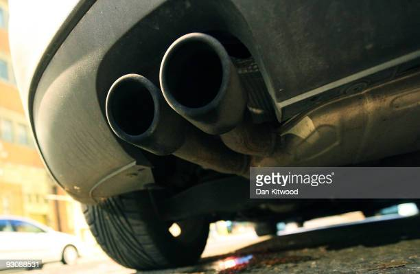 An exhaust pipe sticks out the rear of a car parked on a street on November 16 2009 in London England As world leaders prepare to gather for the...