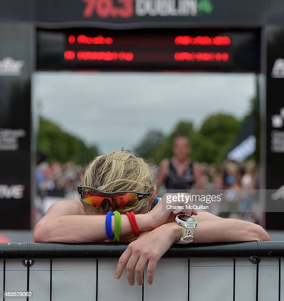An exhausted athlete after she crosses the finish line during the Ironman triathlon event on August 9 2015 in Dublin Ireland More than 2500 athletes...