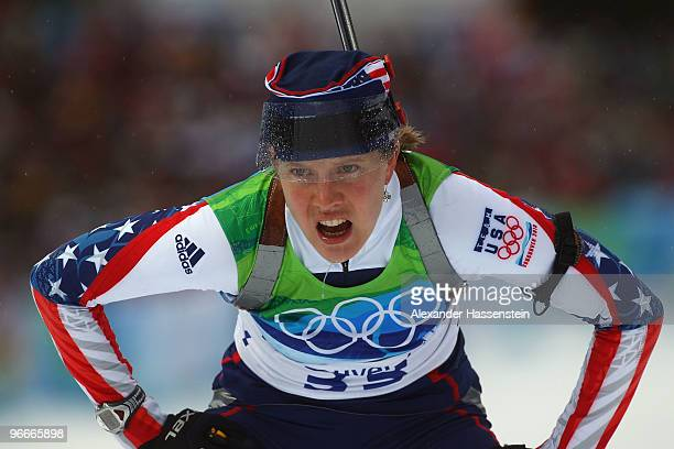 An exhausted Haley Johnson of United States reacts after crossing the finish line during the Women's Biathlon 75 km Sprint on day 2 of the Vancouver...