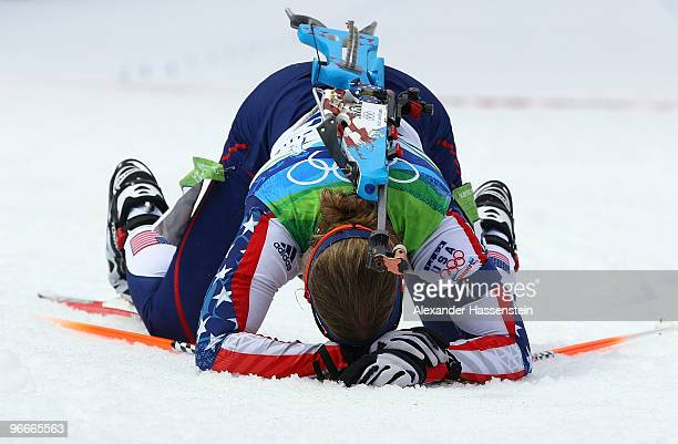 An exhausted Lanny Barnes of United States reacts after crossing the finish line during the Women's Biathlon 75 km Sprint on day 2 of the Vancouver...