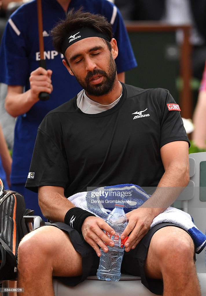An exhausted <a gi-track='captionPersonalityLinkClicked' href=/galleries/search?phrase=Marcos+Baghdatis&family=editorial&specificpeople=226943 ng-click='$event.stopPropagation()'>Marcos Baghdatis</a> of Cyprus reacts during the Men's Singles second round match against Jo-Wilfried Tsonga of France on day five of the 2016 French Open at Roland Garros on May 26, 2016 in Paris, France.