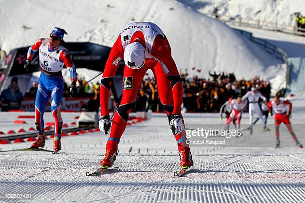 An exhausted Petter Northug of Norway crosses the finish line to win the gold medal in the Men's Cross Country 50km Mass Start race during the FIS...