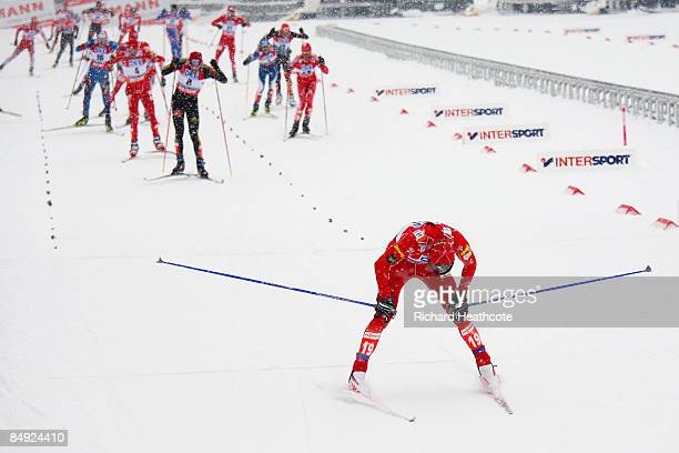 An exhausted Todd Lodwick of USA reacts as he crosses the finish line to win the 10km Mass Start race of the Nordic Combined event at the FIS Nordic...