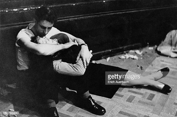 An exhausted young couple during an allnight jazz session at the Royal Albert Hall in London circa 1957