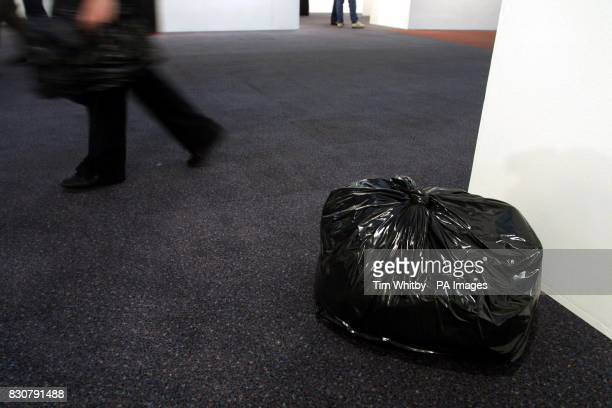 An exhibit of a rubbish bag cast in bronze by artist Gavin Turk on display at the press preview day of the Art 2002 London Art Fair at the Business...