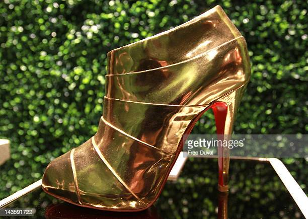 An exhibit on display during a preview of an exhibition celebrating 20 years of designs by French shoe designer Christian Louboutin at the Design...
