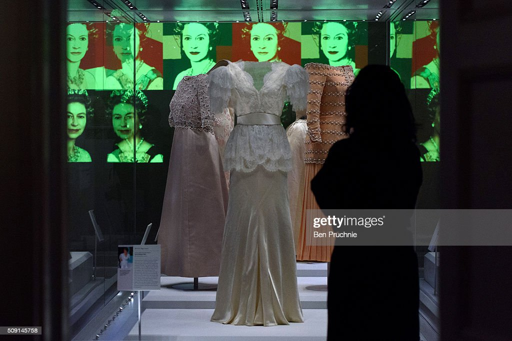 An exhibition assistant looks at a Bruce Oldfield dress that was worn by Princess Diana is displayed at the Fashion Rules Exhibition at Kensington Palace on February 9, 2016 in London, England. The exhibition, that re-opens to the public on February 11, contains pieces including the dress Queen Elizabeth II wore for her official Silver Jubilee photograph and a dress worn by Diana, Princess of Wales for her last official photo shoot with famed photographer Mario Testino