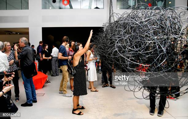 An exhibiton visitor tests the cable cloud of artist Christian Kubisch during the 'Ars Electronica' Group Exhibition and 'Dritte Landschaft/Third...
