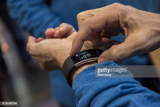 An exhibitor demonstrates the Microsoft Band at the Microsoft Developers Build Conference in San Francisco California US on Thursday March 31 2016...