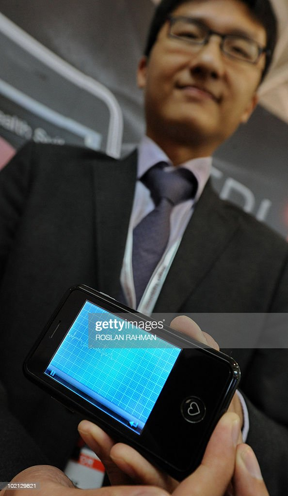An exhibitor holds a EPI Life smartphone that can detect a person's abnormal heart rhythm, at the CommunicAsia 2010 conference and exhibition show in Singapore on June 16, 2010. With EPI Life, a 106-gram touch-screen phone on exhibit at a technology conference in Singapore, your electrocardiogram (ECG) chart will be literally at your fingertips within minutes. An ECG, usually conducted at a clinic or hospital, can detect a person's abnormal heart rhythm, allowing the individual to seek immediate medical attention.